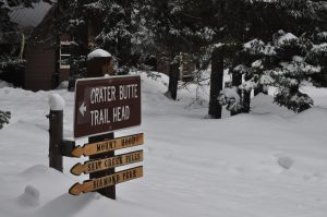 Crater Butte Trailhead sign in the snow