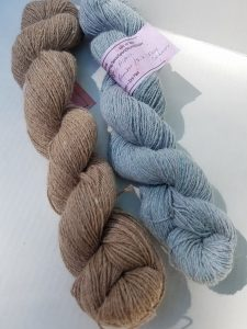 Two skeins of lovely yarn from last year's giveaway.